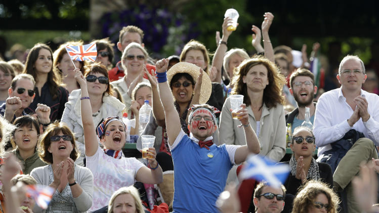 Spectators cheer as they watch a giant display showing Andy Murray of Britain playing Jo-Wilfried Tsonga of France in a men's semifinals match at the All England Lawn Tennis Championships at Wimbledon, England, Friday, July 6, 2012. (AP Photo/Kirsty Wigglesworth)