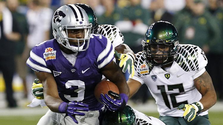 Kansas State wide receiver Chris Harper (3) is tackled by Oregon linebacker Michael Clay (46) during the first half of the Fiesta Bowl NCAA college football game, Thursday, Jan. 3, 2013, in Glendale, Ariz. (AP Photo/Ross D. Franklin)