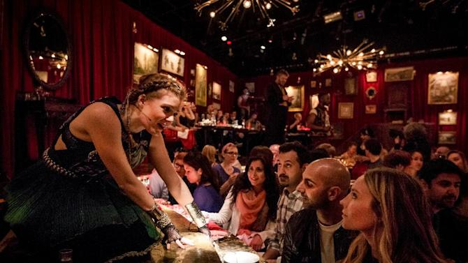 """This undated theater image released by The Hartman Group shows Catherine Brookman in """"Natasha, Pierre and the Great Comet of 1812,"""" a dinner theater performance that opened Thursday, May 15, 2013 in the meatpacking district of New York. (AP Photo/The Hartman Group, Chad Batka)"""