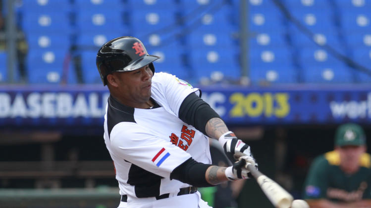 The Netherlands' designated hitter Andruw Jones connects with the ball against Australia in the fifth inning of their World Baseball Classic first round game at the Intercontinental Baseball Stadium in Taichung, Taiwan, Tuesday, March 5, 2013. (AP Photo/Wally Santana)