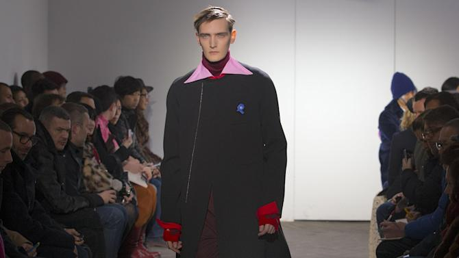 A models wears a creation by Belgian fashion designer Raf Simons fashion house Men's Spring-Summer 2013 collection, for Paris Fashion Week, in Paris, France, Wednesday, Jan. 16, 2013. (AP Photo/ Jacques Brinon)