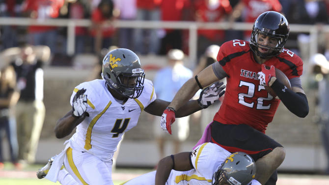 Texas Tech's Jace Amaro is hit by West Virginia's Darwin Cook (25) and Josh Francis during an NCAA college football game in Lubbock, Texas, Saturday, Oct. 13, 2012. Texas Tech won 49-14. (AP Photo/Lubbock Avalanche-Journal, Scott MacWatters) LOCAL TV OUT