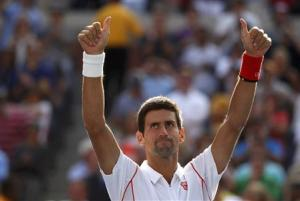 Djokovic of Serbia celebrates after defeating Wawrinka of Switzerland during their men's semi-final match at the U.S. Open tennis championships in New York