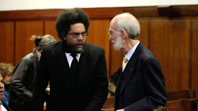 Attorney Martin Stolar, right, confers with  Princeton University professor and civil rights activist Cornel West, in criminal court in New York, Monday, April 30, 2012.  West and nearly two dozen demonstrators arrested last year while protesting the New York Police Department's stop-and-frisk policy have gone on trial. (AP Photo/Richard Drew, Pool)