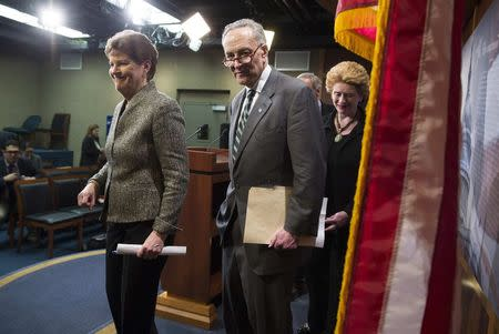 Senators Jeanne Shaheen (D-NH), Charles Schumer (D-NY) and Debbie Stabenow (D-MI) depart a news conference after a vote on legislation for funding the Department of Homeland Security