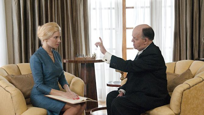 "This image released by HBO shows Toby Jones, portraying Alfred Hitchcock, right, with Sienna Miller, portraying Tippi Hedren, in a scene from the film ""The Girl,"" premiering Saturday, Oct. 20, 2012 at 9 p.m. EST. The HBO movie dramatizes the making of Hitchcock's ""The Birds"" and his relationship with Hedren. (AP Photo/HBO, Kelly Walsh)"