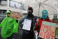 Czech demonstrators stand with banners in front of the Russian embassy to the Czech Republic to demonstrate against the imprisonment of members of the feminist punk band &#39;&#39;Pussy Riot&#39;&#39; in Prague on April 15. Journalists, bloggers, relatives and supporters have crowded since Monday into Moscow&#39;s 40-seater Khamovnichesky courtroom for hearings in the three women&#39;s case