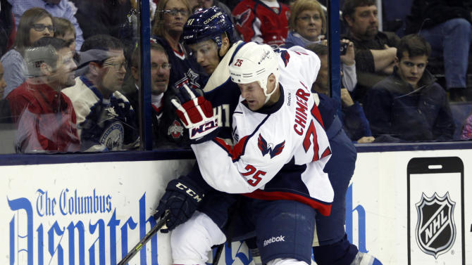 Washington Capitals' Jason Chimera, right, checks Columbus Blue Jackets' Alexander Wennberg, of Sweden, during the second period of an NHL hockey game in Columbus, Ohio, Tuesday, March 3, 2015. (AP Photo/Paul Vernon)