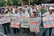 <p>Greek pensioners march towards the Health Ministry in Athens on Thursday to protest about healthcare charges. The International Monetary Fund said Thursday that Greece has failed to meet a number of targets in the IMF bailout program, insisting it is too soon to discuss revisions to the plan.</p>