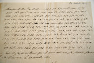 In this photo taken Wednesday, Nov. 28, 2012, a letter dictated by Napoleon in secret code that declares his intentions &quot;to blow up the Kremlin&quot; during his ill-fated Russian campaign is displayed in Fontainebleau, outside Paris. The rare letter, written in unusually emotive language, sees Napoleon complain of harsh conditions and the shortcomings of his grand army. The letter goes on auction Sunday, Dec. 2, 2012. (AP Photo/Christophe Ena)