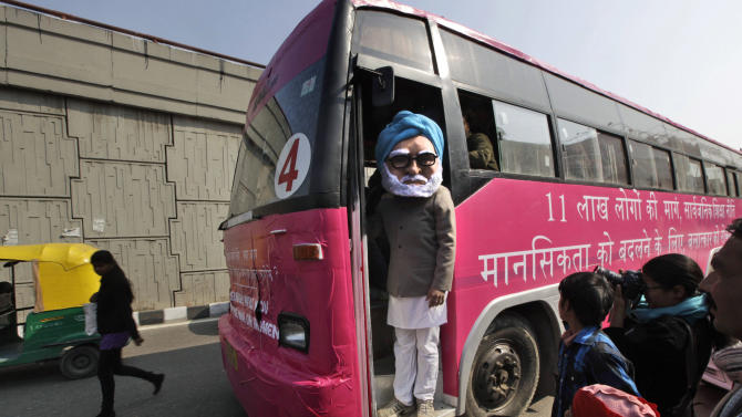 An activist dressed as Indian Prime Minister Manmohan Singh stands on a pink bus meant to spread awareness on violence against women, in New Delhi, India, Thursday, Jan. 24, 2013. The trial of five men accused of the rape and murder of a young woman on a moving bus in New Delhi last month was set to begin Thursday in a special fast-track court set up after the attack ignited outrage and questions over the treatment of women in the country's justice system. (AP Photo /Manish Swarup)