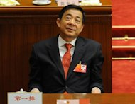 Fallen Chinese politician Bo Xilai, pictured here in March, is likely to face criminal trial for trying to protect his wife from murder charges, analysts said Thursday, after his former police chief was tried for defection