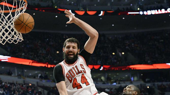 Chicago Bulls forward Nikola Mirotic (44) is fouled by Oklahoma City Thunder center Enes Kanter (34) during the second half of an NBA basketball game, in Chicago, Thursday, March 5, 2015.  The Bulls won 108-105.  (AP Photo/David Banks)