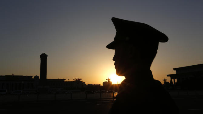 A Chinese paramilitary policeman stands guard in front of the Great Hall of the People where the opening session of the 18th Communist Party Congress is held, in Beijing Thursday, Nov. 8, 2012. China's ruling Communist Party opened a congress Thursday to usher in a new group of younger leaders faced with the challenging tasks of righting a flagging economy and meeting public calls for better government. (AP Photo/Vincent Yu)