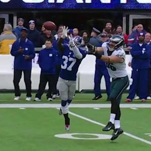 New York Giants defensive back Mike Harris picks off Mark Sanchez