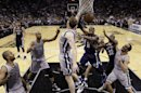Memphis Grizzlies&#039; Mike Conley (11) is defended by San Antonio Spurs&#039; Matt Bonner, center, as he tries to score during the first half in Game 1 of a Western Conference Finals NBA basketball playoff series Sunday, May 19, 2013, in San Antonio. (AP Photo/Eric Gay)