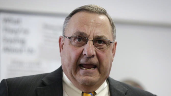 FILE - Maine Gov. Paul LePage criticizes the state's Legislature during a news conference in this March 10, 2014 file photo taken in Brunswick, Maine. LePage wants to limit state welfare benefits to only those residents living in Maine legally, a move that could force municipalities to drop some recipients or risk losing government funds. Attorney General Janet Mills, a Democrat, says the governor has no authority to implement the change in welfare regulations without legislative approval. (AP Photo/Robert F. Bukaty)