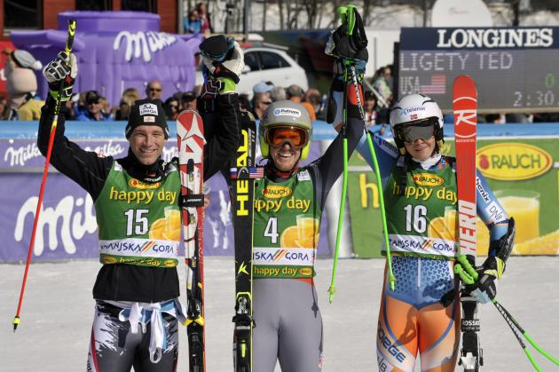 Winners celebrate in the finish area after the Alpine Skiing World Cup men's giant slalom ski race in Kranjska Gora