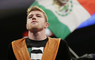 Alvarez enters the ring prior to his fight against Lara. (AP)
