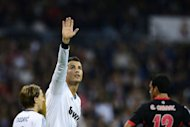 Real Madrid&#39;s forward Cristiano Ronaldo celebrates after scoring during their Spanish League football match against Celta de Vigo at the Santiago Bernabeu stadium in Madrid. Real Madrid won 2-0
