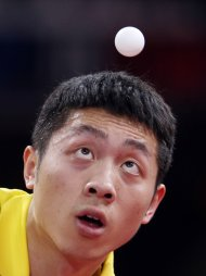 Xu Xin of China eyes the ball as he serves to Marcos Freitas of Portugal during their men&#39;s singles fourth round match at the World Team Table Tennis Championships in Paris May 18, 2013. The 52nd edition of the World Table Tennis Championships gathers 829 athletes from 162 countries and runs from May 13 to May 20. REUTERS/Charles Platiau (FRANCE - Tags: SPORT TABLE TENNIS)