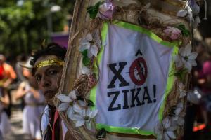 Revelers wearing Greek style costumes raise awareness…