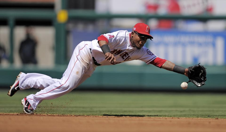 Los Angeles Angels shortstop Erick Aybar can't reach a ball hit by New York Yankees' Eric Chavez for an RBI single during the second inning of their baseball game, Sunday, Sept. 11, 2011, in Anaheim, Calif.  (AP Photo/Mark J. Terrill)