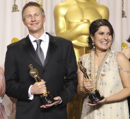 "Sharmeen Obaid-Chinoy, right, and Daniel Junge pose with their awards for best documentary short for ""Saving Face"" during the 84th Academy Awards on Sunday, Feb. 26, 2012, in the Hollywood section of Los Angeles. (AP Photo/Joel Ryan)"