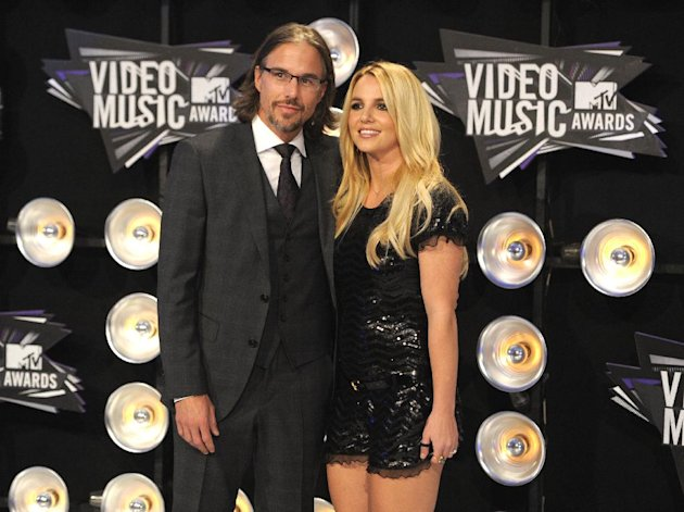 FILE - In this Aug. 28, 2011 file photo, Jason Trawick and Britney Spears arrive at the MTV Video Music Awards in Los Angeles. A judge says Spears&#39; one-time fiance Jason Trawick has resigned as her co-conservator on Friday Jan. 11, 2013. (AP Photo/Chris Pizzello, file)
