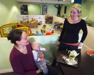 Stacey Bebbington serves Elizabeth Howell and her son Francois, 5-1/2 months, at her family friendly coffee shop Wednesday, October 9, 2013 in Montreal. From cafes to comic books, Canadian businesses are turning to crowdfunding.THE CANADIAN PRESS/Ryan Remiorz