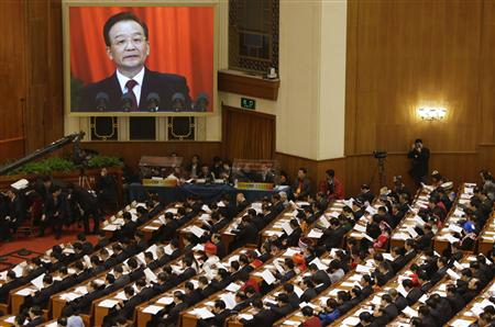 China's Premier Wen Jiabao (shown on screen) speaks as delegates listen during the opening ceremony of National People's Congress (NPC) at the Great Hall of the People in Beijing, March 5, 2013. REUTERS/Jason Lee