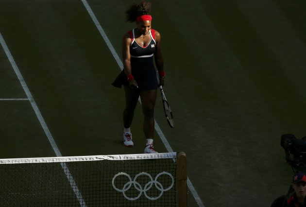 Serena Williams of the U.S. pauses in her women's singles tennis semi-final match against Belarus' Azarenka at the All England Lawn Tennis Club during the London 2012 Olympic Games