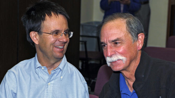 David Wineland, right, an American physicist at the National Institute of Standards in Boulder, who shares the 2012 Nobel Prize in Physics with Serge Haroche of France, is pictured with fellow NIST physicist Eric Cornell, left,  at a news conference at NIST in Boulder, Colo., on Tuesday, Oct. 9, 2012. Cornell won the Nobel Prize in 2001.(AP Photo/Ed Andrieski)
