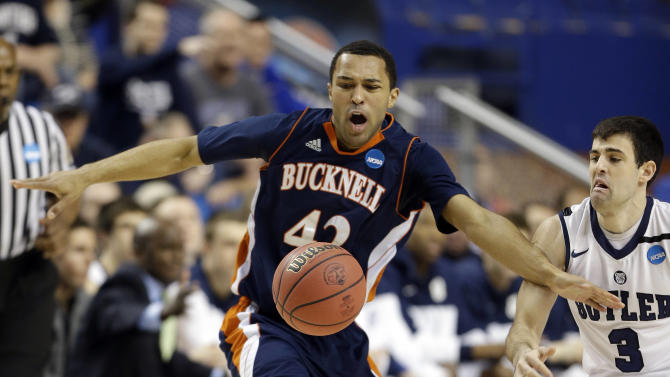 Bucknell guard Cameron Ayers (42) has the ball knocked away by Butler guard Alex Barlow (3) during the first half their second round NCAA college basketball tournament game Thursday, March 21, 2013, in Lexington, Ky.  (AP Photo/John Bazemore)