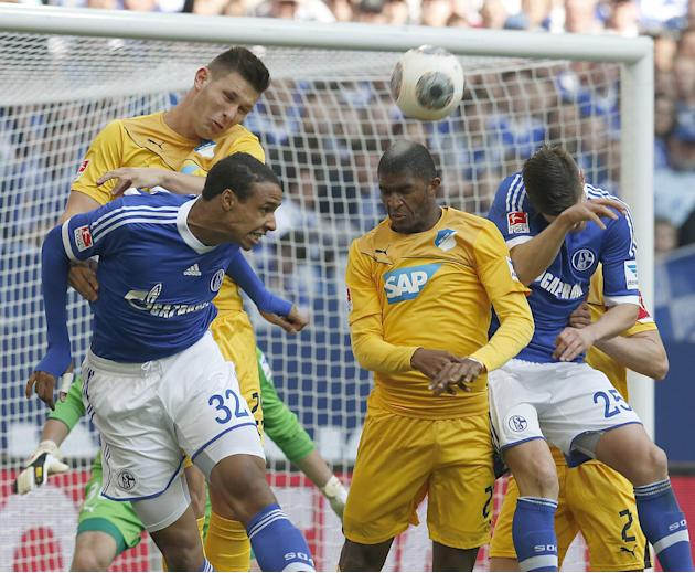 Schalke's Joel Matip of Cameroon, front left, heads the ball during the German first division Bundesliga soccer match between Schalke 04 and 1899 Hoffenheim in Gelsenkirchen, Germany, Saturday, Ma