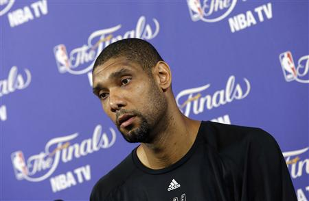 San Antonio Spurs' Duncan speaks to media during a team practice ahead of Game 7 of the NBA Finals basketball playoff against the Miami Heat in Miami