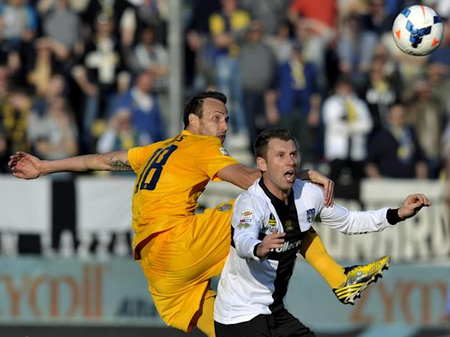Parma's Antonio Cassano, right, vies for the ball with Verona's Vangelis Moras of Greece, during their Serie A soccer match at Parma's Tardini stadium, Italy, Sunday, March 9, 2014