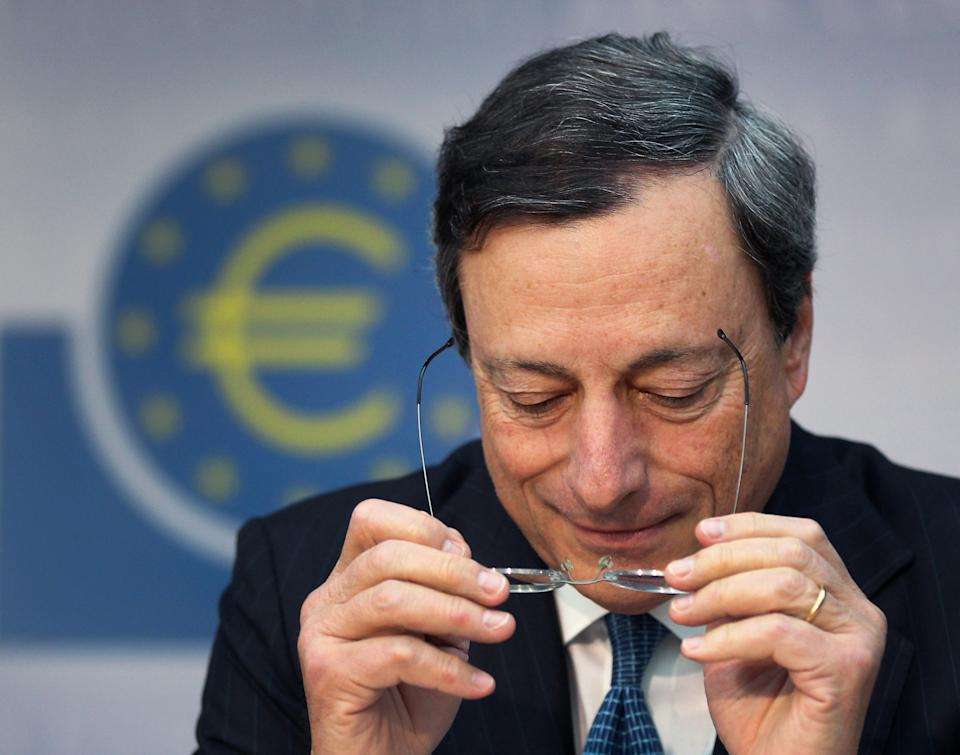 President of European Central Bank adjusts his glasses during a news conference in Frankfurt, Germany, Thursday, Aug. 2, 2012, following a meeting of the ECB governing council concerning the further strategies in the European financial crisis. (AP Photo/Michael Probst)