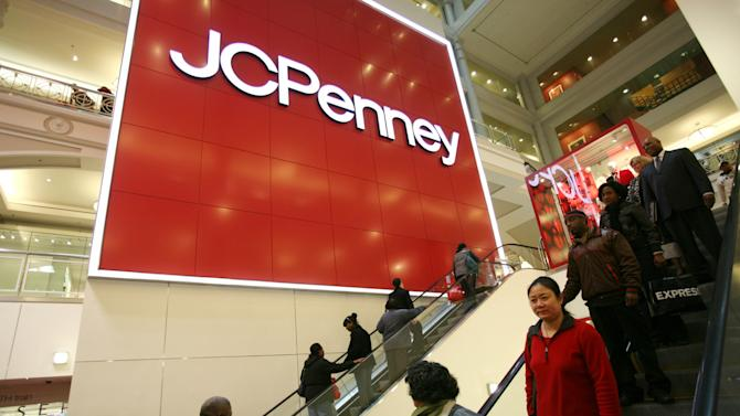 FILE - In this Friday, Oct. 23, 2009 file photo, shoppers visit a J.C. Penney store in New York. J.C. Penney's stock plunged 18 percent on Wednesday, May 16, 2012 — the biggest drop by percentage since the market crash in 1987. The decline comes a day after the retailer reported a larger-than-expected first-quarter loss largely because customers were turned off by its new everyday low pricing strategy. (AP Photo/Mark Lennihan, File)