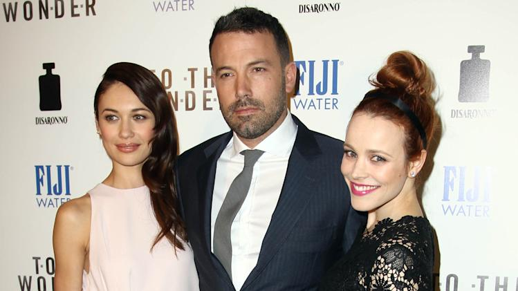 "IMAGE DISTRIBUTED FOR FIJI WATER - Cast members Ben Affleck, center, Rachel McAdams, right, and Olga Kurylenko pose together at the premiere of ""To The Wonder"" hosted by FIJI Water on Tuesday, April 9, 2013 in Los Angeles. (Photo by Matt Sayles/Invision for Fiji Water/AP Images)"