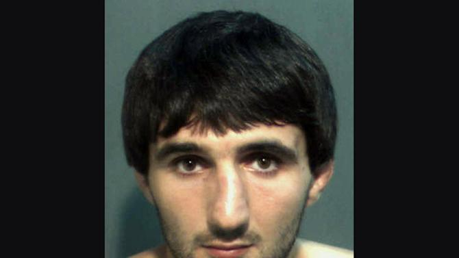 This May 4, 2013 police photo provided by the Orange County Corrections Department in Orlando, Fla., shows Ibragim Todashev after his arrest for aggravated battery in Orlando. Todashev, who was being questioned in Orlando by authorities in the Boston bombing probe, was fatally shot Wednesday, May 22, 2013 when he initiated a violent confrontation, FBI officials said. (AP Photo/Orange County Corrections Department)