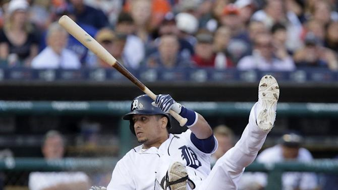 Detroit Tigers' Victor Martinez hits the ground while avoiding an inside pitch from Toronto Blue Jays' Drew Hutchison during the fourth inning of a baseball game Friday, July 3, 2015, in Detroit. (AP Photo/Duane Burleson)