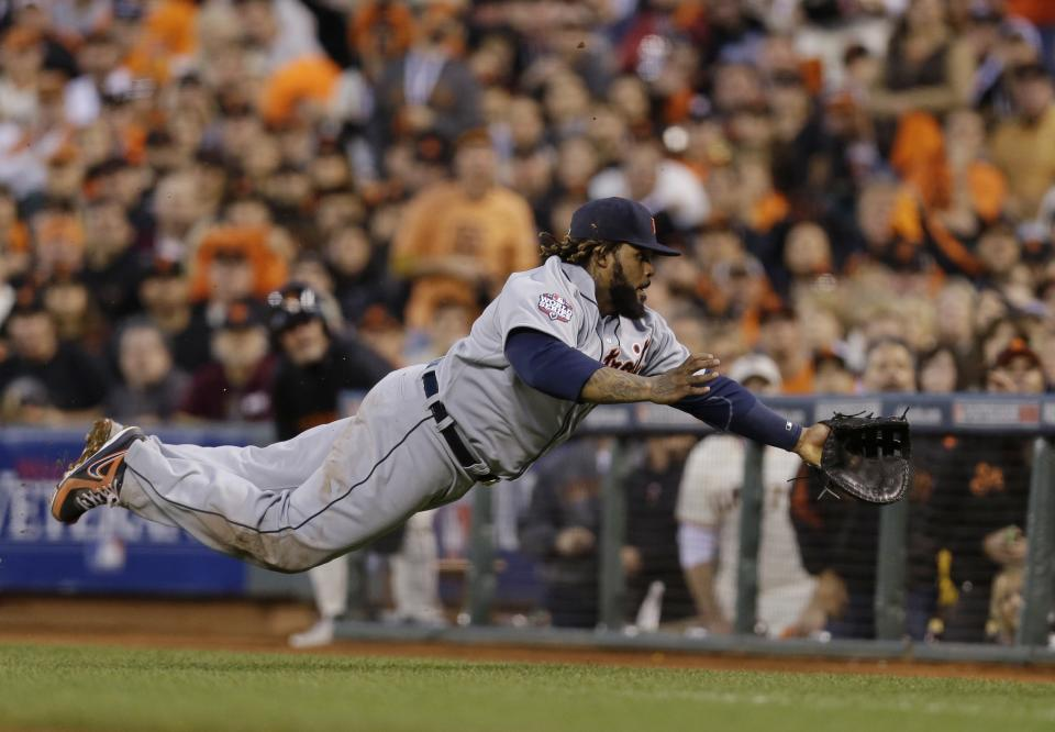 Detroit Tigers first baseman Prince Fielder dives for a foul ball hit by San Francisco Giants' Hunter Pence during the fourth inning of Game 2 of baseball's World Series Thursday, Oct. 25, 2012, in San Francisco. (AP Photo/Marcio Jose Sanchez)