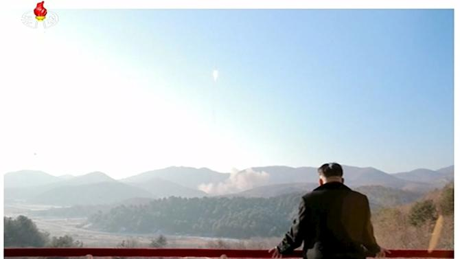 File photo of North Korean leader Kim Jong Un watching a long range rocket launched into the air in this still image taken from KRT footage and released by Yonhap