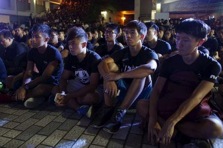 Hong Kong students and university staff rally to defend academic freedom