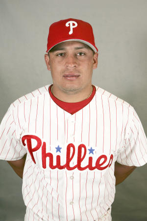 File-This is a 2008 file photo of Carlos Ruiz of the Philadelphia Phillies baseball team. Ruiz has been suspended for the first 25 games of next season following a positive test for an amphetamine in violation of Major League Baseball's Joint Drug Prevention and Treatment Program. Ruiz's suspension was announced Tuesday Nov. 27, 2012 by Major League Baseball.  (AP Photo/Keith Srakocic,File)