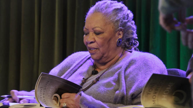 "Author Toni Morrison signs copies of her latest book ""Home,"" during Google's online program series, Authors At Google, on Wednesday, Feb. 27, 2013 in New York.  (AP Photo/Bebeto Matthews)"