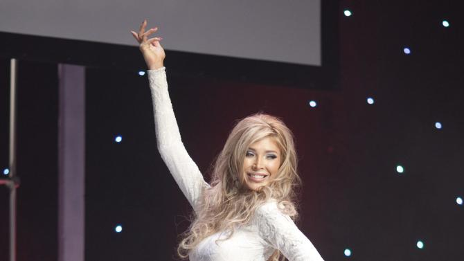 Transgendered beauty queen Jenna Talackova appears in the Miss Universe Canada pageant in Toronto, on Saturday May 19, 2012. Talackova sparked global attention when she was initially disqualified from the pageant. (AP Photo/The Canadian Press,Chris Young)