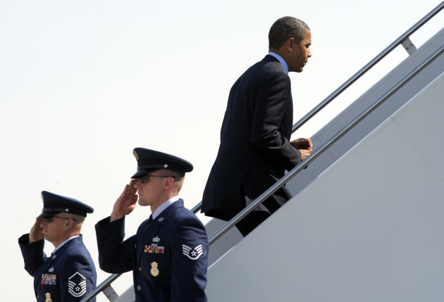 President Barack Obama walks up the steps of Air Force One at Andrews Air Force Base in Md., Tuesday, July 17, 2012. Obama is heading to Texas for fundraising and campaign events. (AP Photo/Susan Walsh)