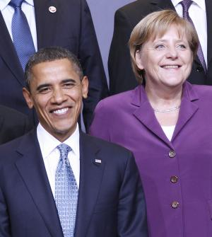 FILE - In this Nov. 19, 2010 file photo, President Barack Obama and German Chancellor Angela Merkel are seen during the NATO Official group photo of the North Atlantic Council summit in Lisbon , Portugal. (AP Photo/Pablo Martinez Monsivais, File)
